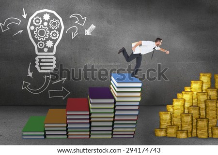 Geeky young businessman running late against steps made of books in front of light bulb drawing - stock photo