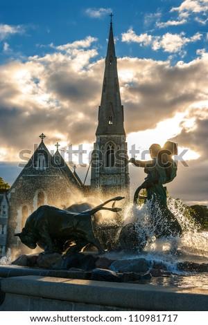 Gefion fountain and St. Alban's church in Copenhagen. Denmark - stock photo
