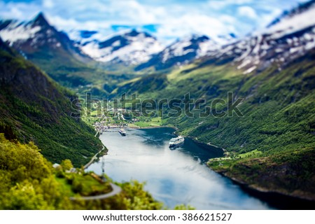 Geiranger fjord, Beautiful Nature Norway (tilt shift lens). It is a 15-kilometre (9.3 mi) long branch off of the Sunnylvsfjorden, which is a branch off of the Storfjorden (Great Fjord). - stock photo
