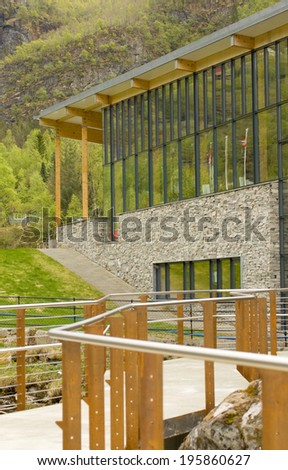 Geiranger fjord center is a modern building located at the end of the new waterfall pathway. - stock photo