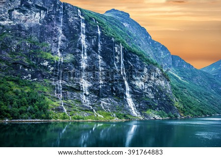 Geiranger fjord, Norway: landscape, mountains and waterfalls Seven Sisters. - stock photo