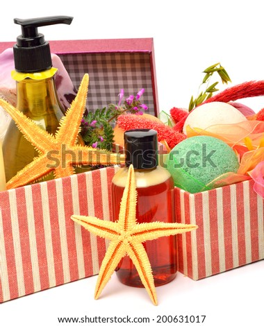 Gel bottles, bath bombs and starfishes in gift boxes isolated on white - stock photo