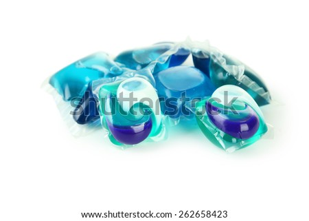 Gel capsules with laundry detergent on a white background - stock photo
