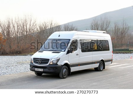 GELENDZHIK, RUSSIA - NOVEMBER 16, 2014: White passenger van Mercedes-Benz Sprinter at the interurban road. - stock photo