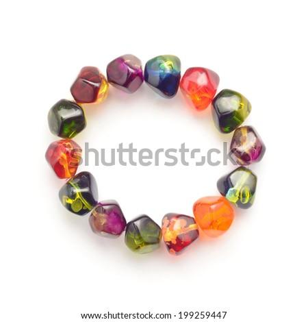 gem stone bracelet on white - stock photo