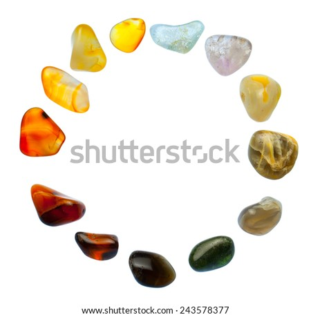 Gemstones on a white. Abstract background with natural semi-precious stones. - stock photo