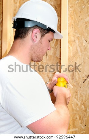 General Contractor Builder Using A Power Screw Driver While Building A New Home - stock photo