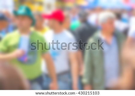 General public concept, blur people, unrecognizable everyday men walking on street out of focus - stock photo