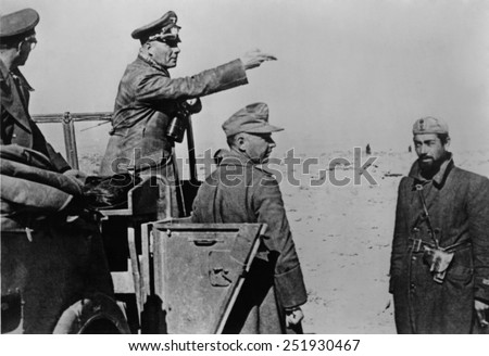 General Rommel standing in jeep in the North African desert, Feb. 1-10, 1942. Rommel's German-Italian forces were resupplied with tanks and fuel in January 1942. He soon captured Benghazi, Libya. - stock photo