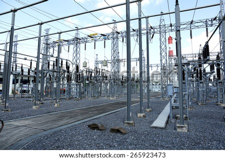 general view to high-voltage substation with switches and gas power plant, gas generator - stock photo