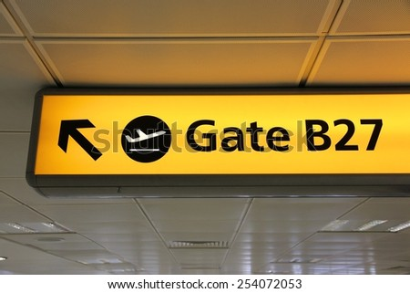 Generic airport signage in London Heathrow. Illuminated gates sign. - stock photo