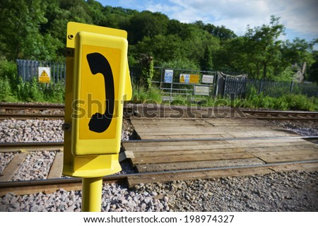 Generic Emergency Telephone by a Railway Crossing - stock photo