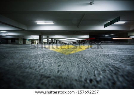 Generic grunge garage parking industrial room interior. - stock photo