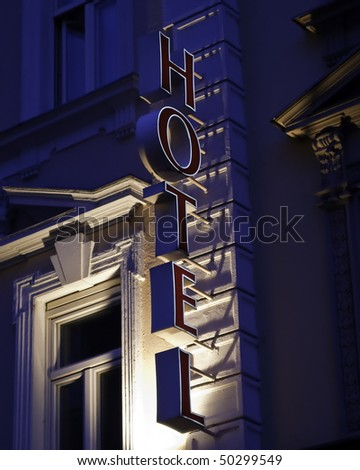 Generic Hotel sign with red letters and white outline - stock photo