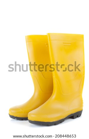 Generic pair of work boots isolated on white background - stock photo