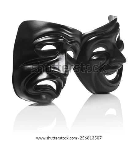 Generic plastic masks as theatrical symbols isolated on white with reflection - stock photo