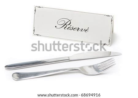 Generic reserved sign in french with fork and knife on white background - stock photo