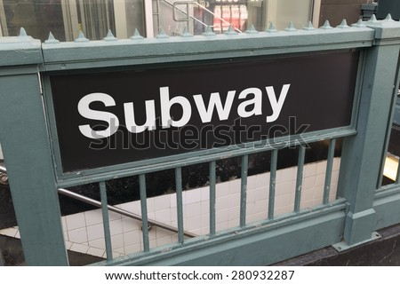 Generic subway sign and entrance - landscape exterior - stock photo