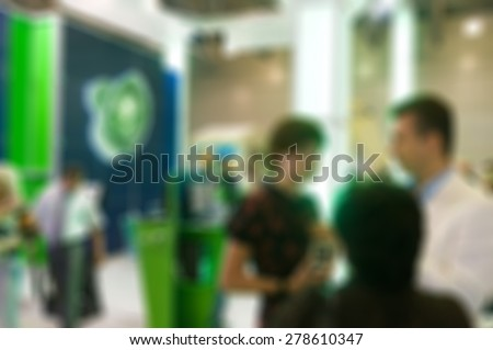 Generic trade show image with blurred defocusing - concept of big business social gathering for international meeting exchange - stock photo
