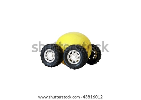 "generic truck wheels on a yellow lemon represents the catch phrase ""this car is a Lemon"" ""isolated on white"" with room for your text - stock photo"