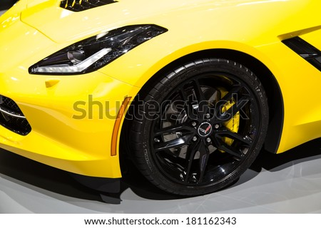 GENEVA, MAR 4: Chevrolet Corvette Stingray wheel and headlight detail, presented at the 84th International Motor Show in Geneva, Switzerland on March 4, 2014. - stock photo