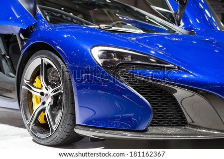GENEVA, MAR 4: McLaren 650s wheel and headlight detail, presented at the 84th International Motor Show in Geneva, Switzerland on March 4, 2014. - stock photo