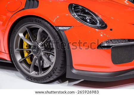 GENEVA, MAR 3: Porsche 911 GT3 RS car wheel and headlight details, presented at the 85th International Motor Show in Geneva, Switzerland on March 3, 2015. - stock photo