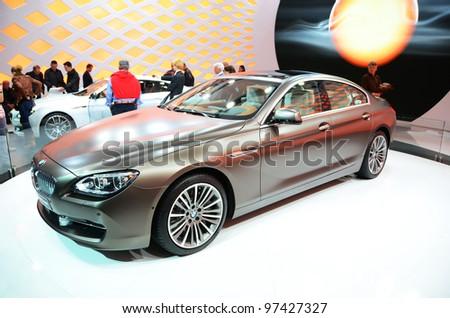 GENEVA - MARCH 12: BMW 6er Gran Coupe on display at 82nd Geneva Motor Show on March 12, 2012 in Geneva, Switzerland. - stock photo