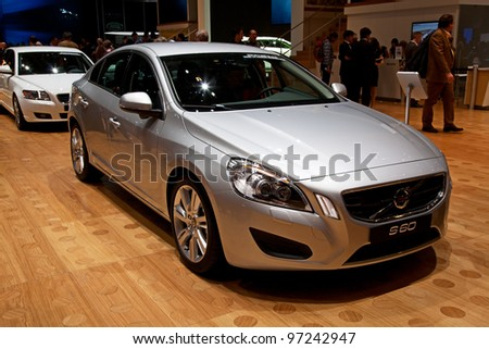 GENEVA - MARCH 8: The Volvo S60 on display at the 81st International Motor Show Palexpo-Geneva on March 8; 2011  in Geneva, Switzerland. - stock photo