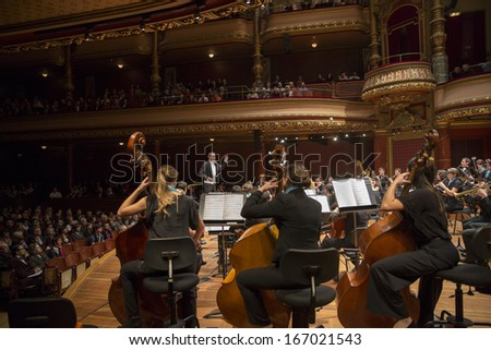 GENEVA - NOVEMBER 30: Antoine Marguier conducts the United Nations Orchestra at the Victoria Hall November 30, 2013 in Geneva, Switzerland. The concert supports PVA-Geneva  work in Cameroon. - stock photo