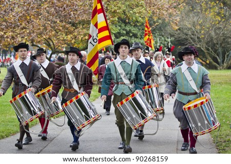 GENEVA - NOVEMBER 13: Soldiers in traditional uniform march at the memorial  service to Geneva soldiers on November 13, 2011 in Geneva Switzerland, attended by veterans and serving soldiers - stock photo