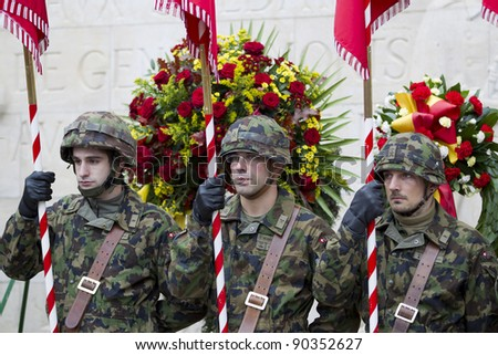 GENEVA - NOVEMBER 13: Soldiers stand to attention at the memorial service to Geneva soldiers on November 13, 2011 in Geneva Switzerland, attended by veterans and serving soldiers - stock photo