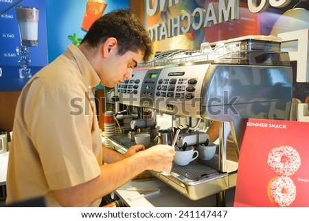 GENEVA - SEP 11: barmen prepare coffee on September 11, 2014 in Geneva, Switzerland. Geneva is the second most populous city in Switzerland and is the most populous city of Romandy - stock photo