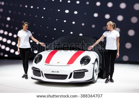GENEVA, SWITZERLAND - MARCH 1: Geneva Motor Show on March 1, 2016 in Geneva, Porsche 911 R, premiere while cover goes off - stock photo