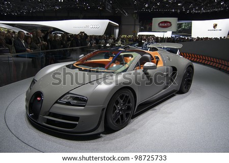GENEVA SWITZERLAND - MARCH 12: The Bugatti Stand displaying a full view of the Veyron convertible in MATT Gunmetal grey, at the Geneva Motorshow on March 12th, 2012 in Geneva, Switzerland. - stock photo