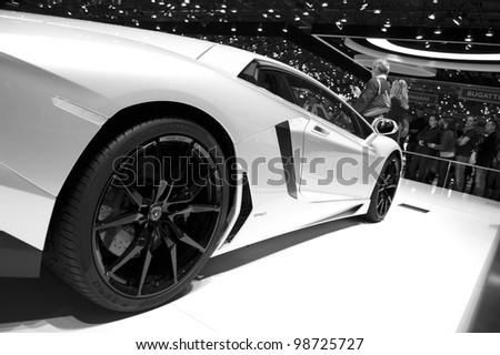 "GENEVA SWITZERLAND - MARCH 12: The Lamborghini Stand displaying a side view of the ""White"" car, at the Geneva Motorshow on March 12th, 2012 in Geneva, Switzerland. - stock photo"