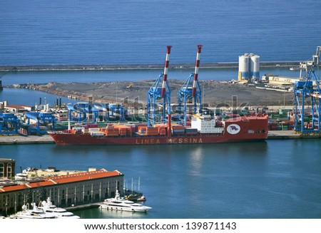 GENOA, ITALY-MAY 8.Jolly Nero cargo ship under sequestration with no visible damage on the day after the collision and the fall of the harbor control tower. Image taken on May 8, 2013 in Genoa harbor. - stock photo
