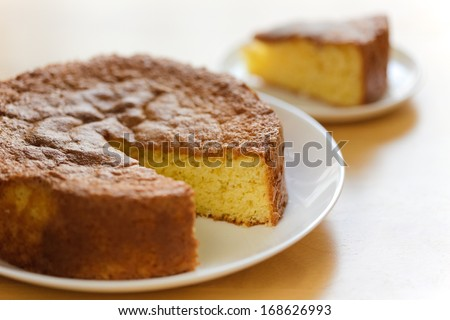 Genoise cake is a French sponge cake made without chemical leavening. It is a basic building block of much French patissierie. Eggs, beaten with sugar, heated to a ribbon stage as patissiers call it.  - stock photo
