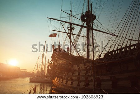 Genova view - old big ship in port of Genoa on sunset - stock photo