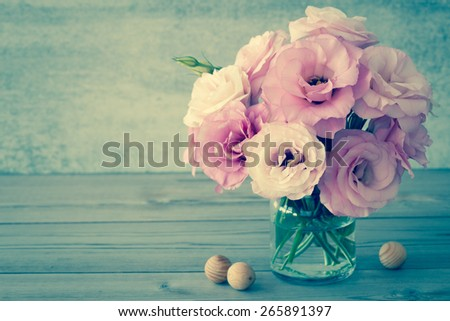 Gentle Flowers in a glass vase with copy space - vintage style still life, toned - stock photo