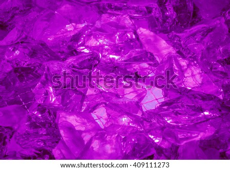 Gentle glare glisten depth dark crimson color druse birthstone stack, mysterious lit by vivid mauve glow. Close-up view with space for text on clear romantic refraction sparkle ice particle heap - stock photo