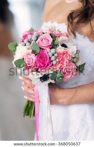 gentle pink bridal bouquet with tapes  - stock photo
