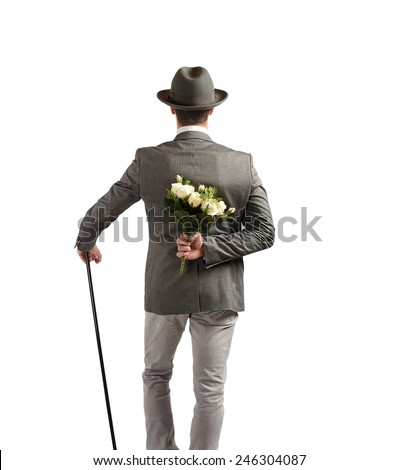 Gentleman gives a bouquet of white roses - stock photo