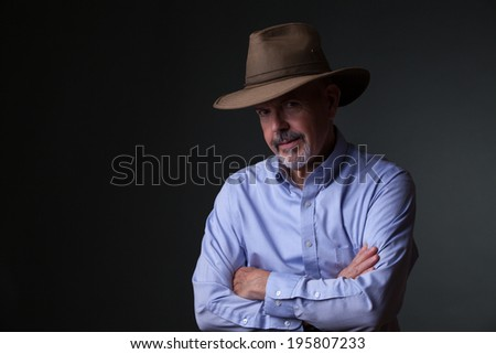 gentleman in shirt and cowboy hat - stock photo