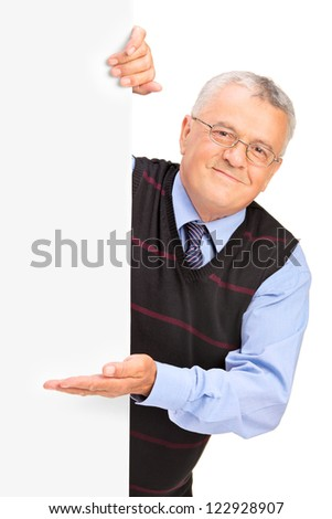 Gentleman posing behind a blank panel and gesturing isolated on white background - stock photo