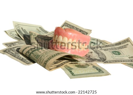Genuine Dentures AKA False Teeth from a Dentist Office on  a pile of cash Isolated on white - stock photo