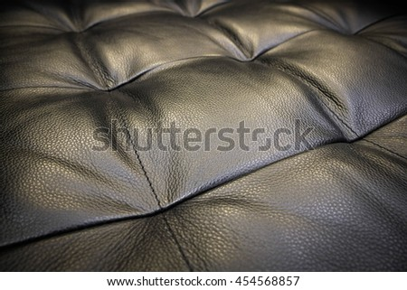 Genuine leather upholstery background for a luxury decoration - stock photo