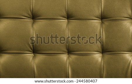 Genuine leather upholstery background for a luxury decoration in gold tones - stock photo