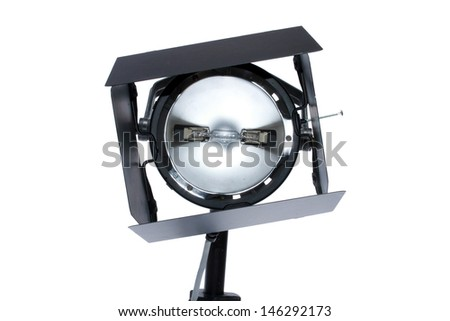 """Genuine PHOTO STUDIO """"Hot Lights"""" with """"barn doors"""" on a tripod on a white background. These lights are used for photo studios and video or movie shoots, this style does get hot and thus the nick name - stock photo"""
