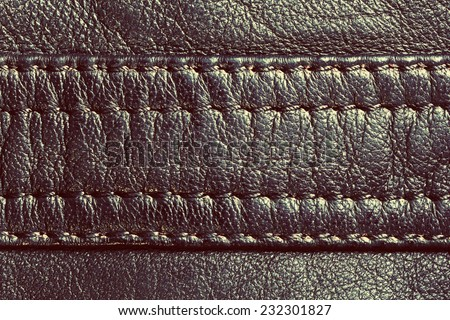 Genuine vintage leather with seam. Background, pattern, texture. - stock photo